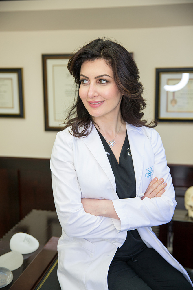 Santa Barbara plastic surgeon, Dr. Sara Yegiyants, in a white doctor's coat