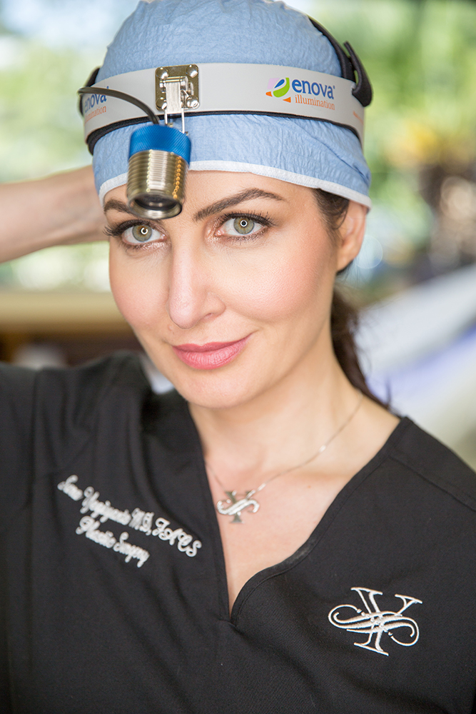 Dr. Sara Yegiyants, plastic surgeon, wearing monogrammed black surgical scrubs