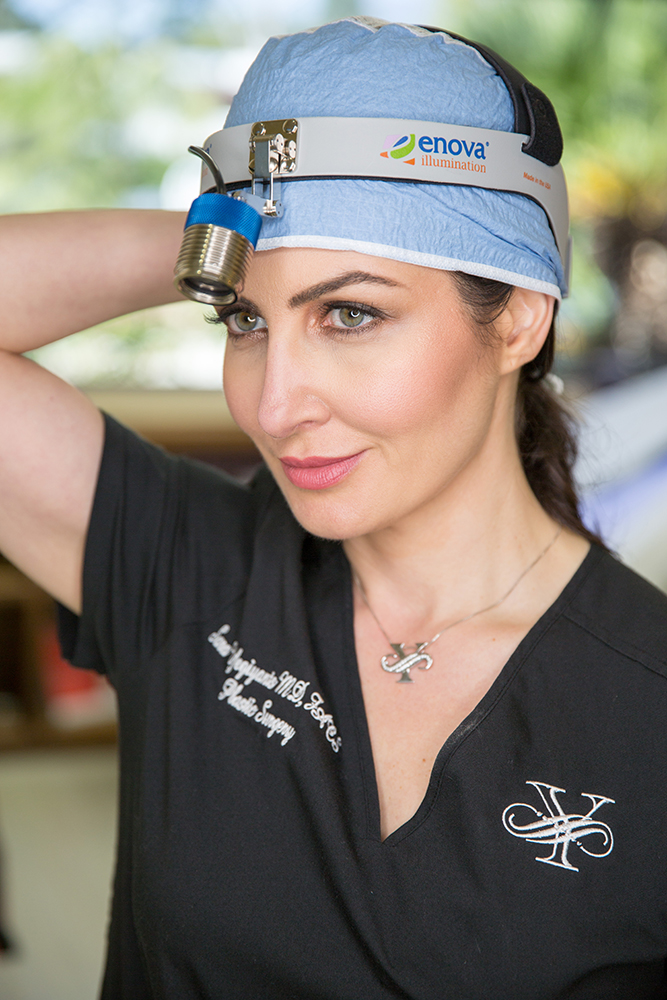 Dr. Sara Yegiyants, Santa Barbara plastic surgeon, in medical scrubs
